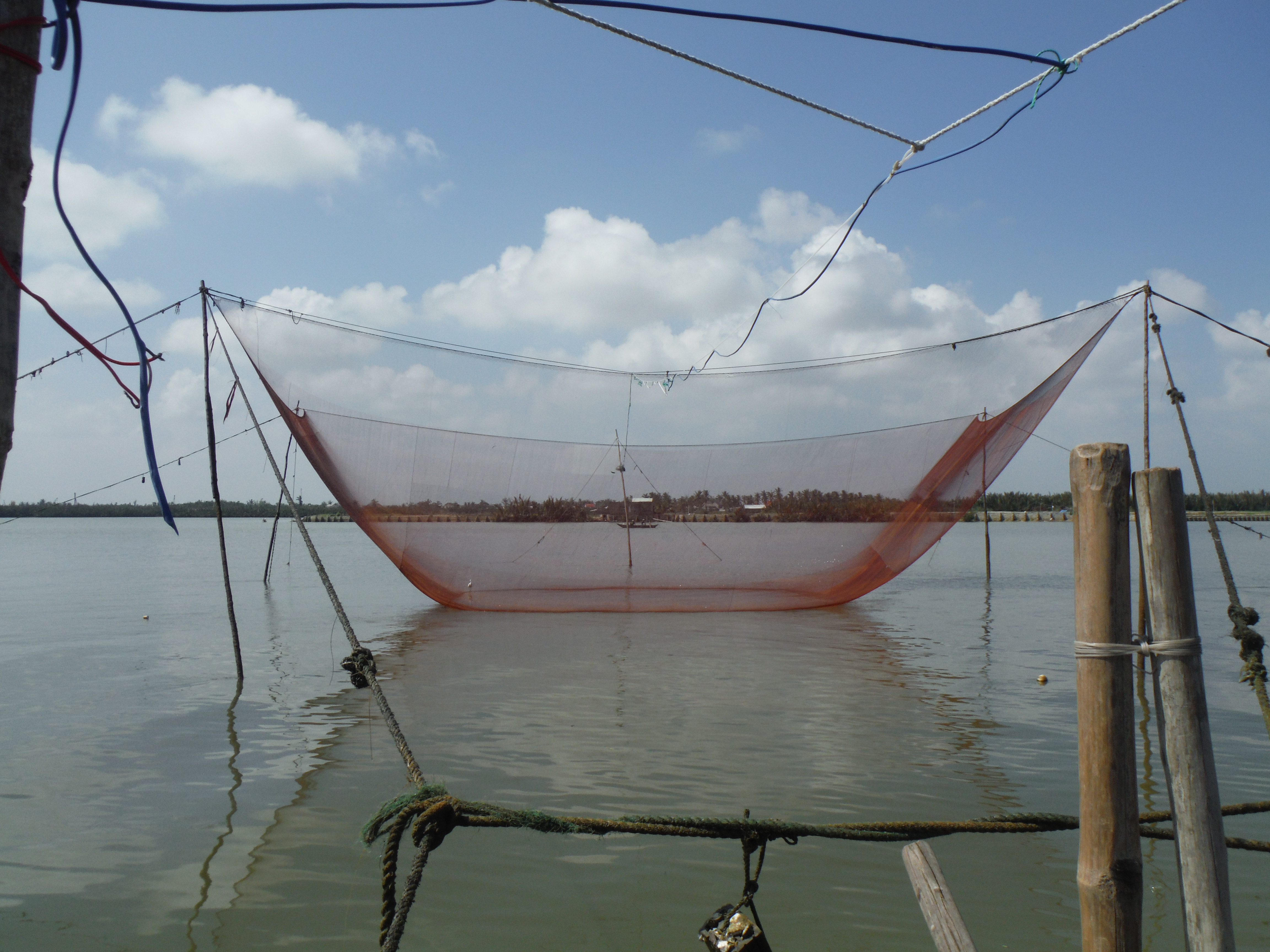 Fish and chips tour hoi an taking the big break for Big fishing net