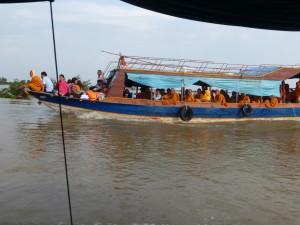 Passing boat full of monks.