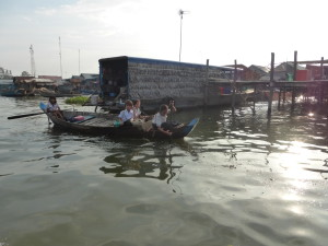 Students in uniform paddling to school