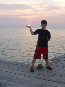 Holding the sun in his hands