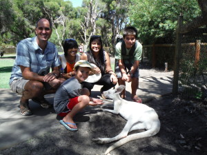 Petting kangaroos with new friends in Australia (whom we met in Laos)